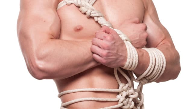 Handsome man in bondage ropes